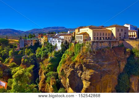 Canyon view with buildings and mountains in Ronda Spain.