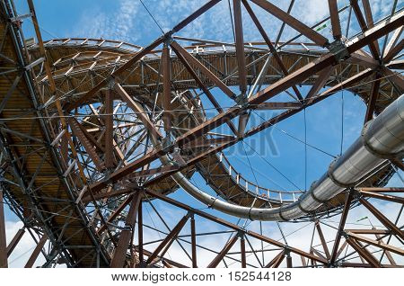 The wooden lookout structure with a steel slide