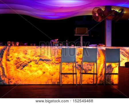 CYPRUS, PROTARAS, STREET BAR - OCTOBER 14, 2016: Bar rack in street bar at night Protaras