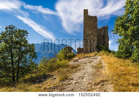 Ruins of Saint-Firmin castle (14th century medieval construction) at the entrance of Valgaudemar valley in the Hautes-Alpes. Summer in the Southern French Alps. France