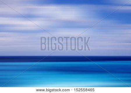 Motion blurred background of refraction in water. Panoramic dramatic view of sea horizon in motion blur.