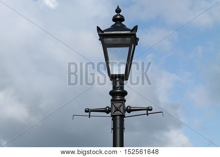 A Stylish Four Sided Metal and Glass Street Lamp.