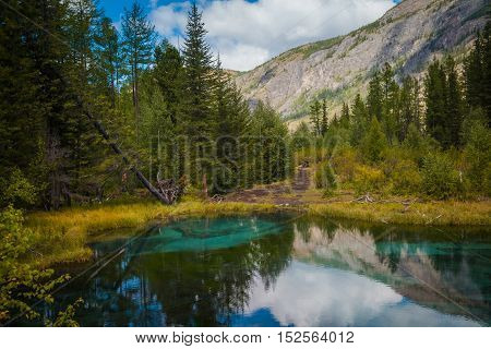 Geyser mountain lake with blue clay. Attraction in Altai, Russia
