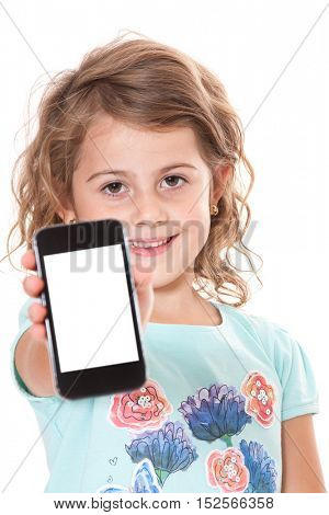 Little girl showing mobile phone. All on white background.