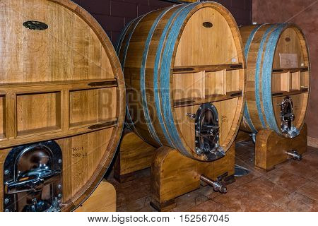 Wine cellar with three large wine vats with serving spigots