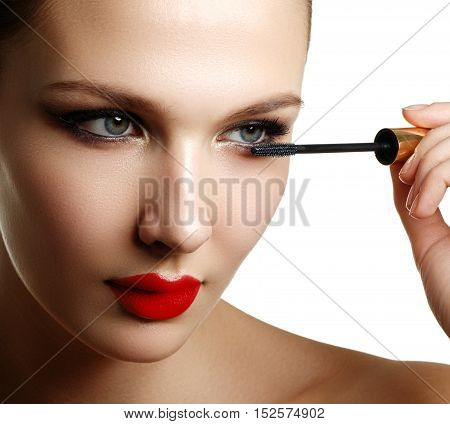 Mascara Applying Closeup, Long Lashes. Mascara Brush. Eyelashes