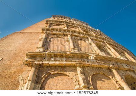Detail exterior of the Flavian Amphitheatre Colosseum, in Rome, Italy