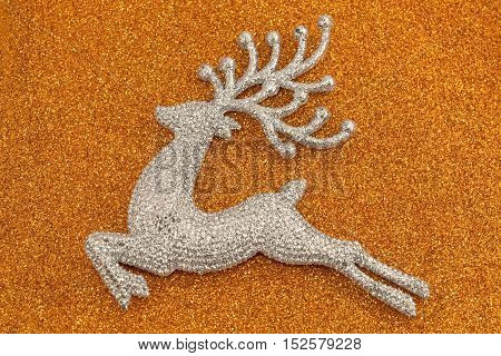 Shinny Christmas deer on a sparkle orange background