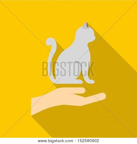 Hand holding a cat icon. Flat illustration of hand holding a cat vector icon for web isolated on yellow background