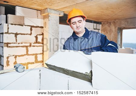 bricklayer at work with silicate brick poster