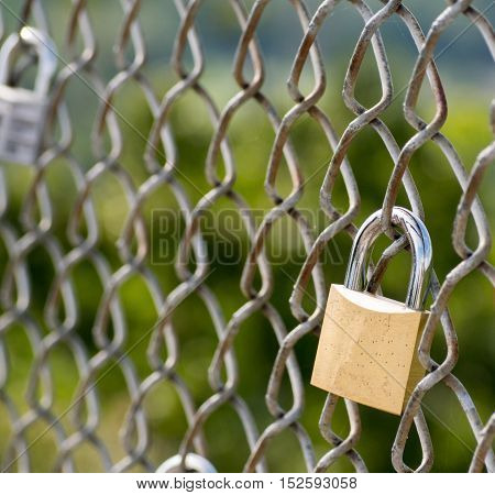 Love locks on chain link fence symbolism of eternal love