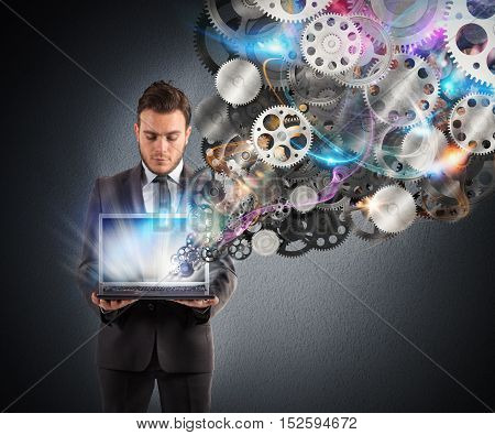 Businessman holds a laptop with gears mechanism that come out from the screen