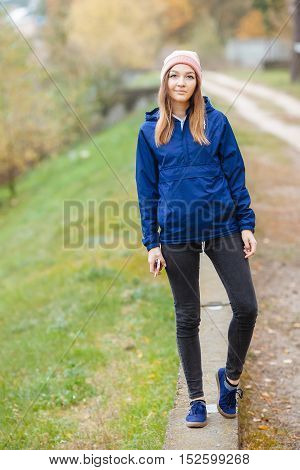Stylish Sporty Brunette Woman Stylish Sporty Brunette Woman Hands In Pockets In Trendy Urban Outwear