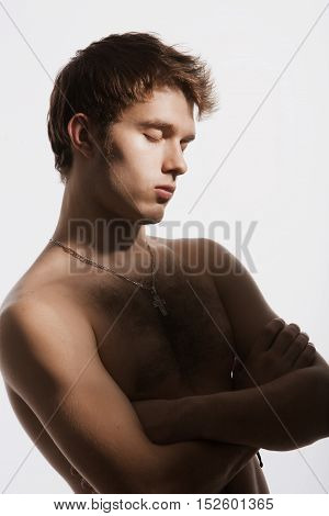 Nude young man closed his eyes dreamily