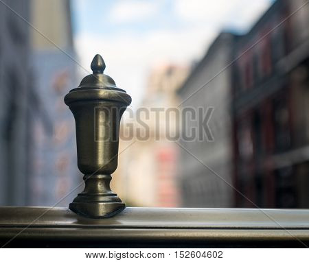 Finial on balcony near city building and urban area on clear day-background photo