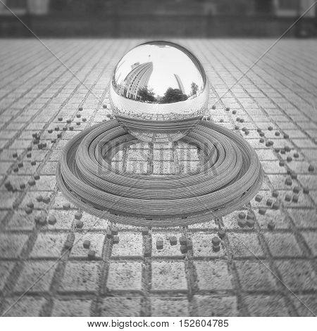 Chrome levitating sphere with reflections located in the center of the town square below her belt circles and small cubes. Abstract background wallpaper in black and white version. 3d illustration