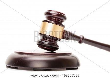 Close up studio shot of wooden judge gavel and soundboard on white background
