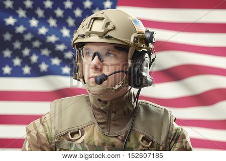 Young Military Man Wearing Helmet With Usa Flag On Background - Studio Shot