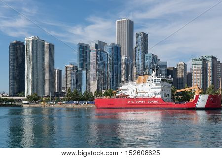 CHICAGO, IL - SEPTEMBER 18, 2016: Chicago skyline with Coast Guard ship docked along the pier