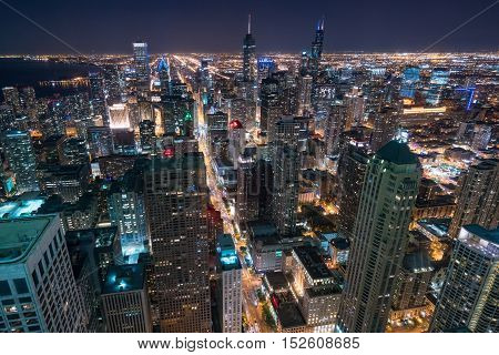 Aerial view Chicago Night Skyline looking south along Lake Michigan