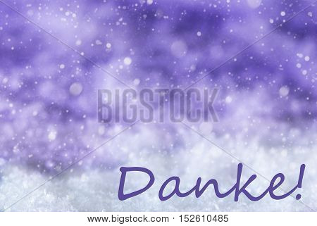 German Text Danke Means Thank You. Purple Christmas Background Or Texture With Snow And Snowflakes. Copy Space For Your Text Here
