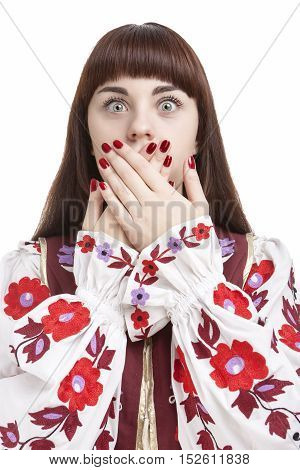 Human Feelings and Emotions Concepts. Young Caucasian Brunette Closing Her Mouth With Folded Palms. Against White Background. Vertical Shot