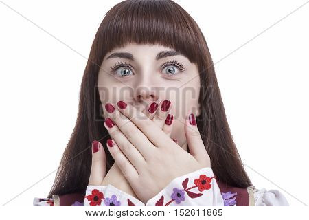 Human Feelings and Emotions Concepts. Young Caucasian Brunette Closing Her Mouth With Folded Palms. Against White Background. Horizontal Image Concept