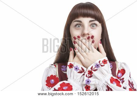 Human Feelings and Emotions Concepts. Young Caucasian Brunette Closing Her Mouth With Folded Palms. Frightened Facial Expression.Horizontal Image