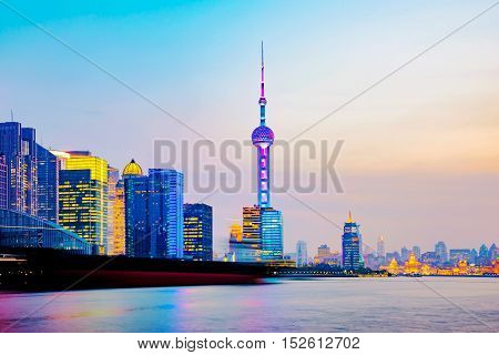 View of Shanghai financial district at night time with Huangpu river