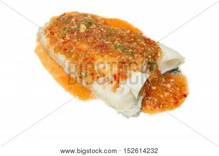 steam Snow-fish with spicy sauce on white plate