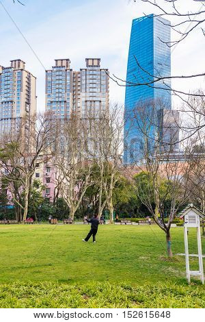 Man doing Tai Chi in a park in Shanghai