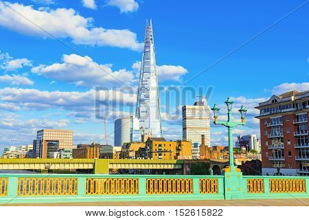 LONDON - JULY 06 2016: The shard building is a famous landmark in London's financial district. This photograph was taken from Southwark bridge which is also a British landmark on July 06 2016 in London.