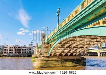 Southwark bridge with blue sky in central London