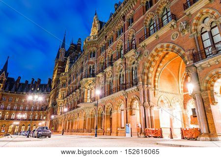 LONDON - JULY 06 2016: Kings cross st pancras international train station at night time. It is a famous British landmark and a very busy train station. on July 06 2016 in London.