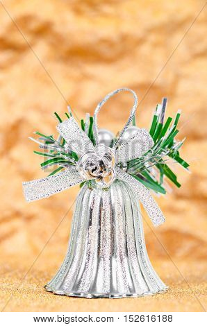 Silver bell decorate for christmas on gold background.