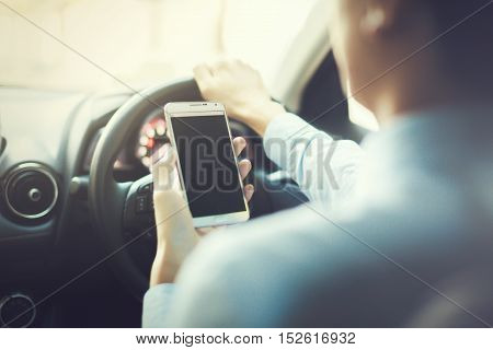 Man Using Phone While Driving The Car (selective Focus) - Transportation And Vehicle Concept - Vinta