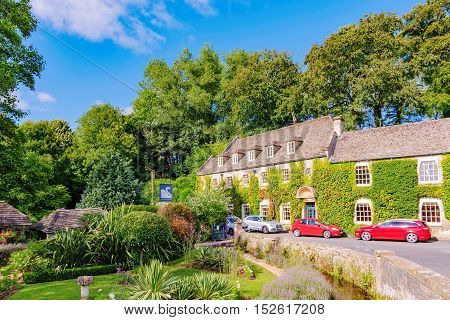 BIBURY UNITED KINGDOM - AUGUST 08: This is the Swan hotel in Bibury town in the Cotswolds area. This is one of the main hotels in the area where many tourists stay on August 08th 2016 in Cotswolds