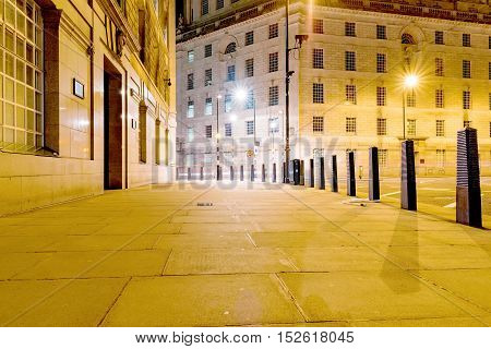 Street in Central London at night with architecture