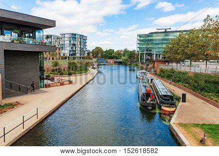 LONDON - AUGUST 22: This is the Regents Canal in Kings Cross just outside the Central Saint Martins university Campus where you can see many students on August 22nd 2016 in London