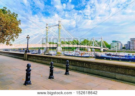 Riverside view of Chelsea bridge on a sunny day