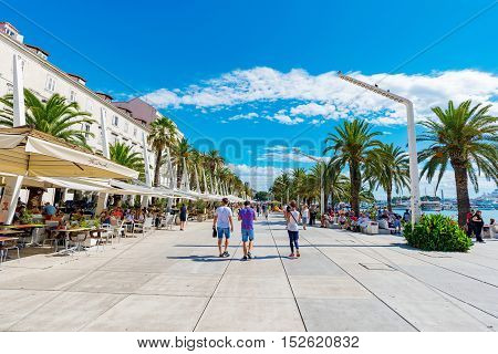 SPLIT CROATIA - SEPTEMBER 17: Seafront promenade area with restaurants and cafes on a sunny day on September 17 2016 in Split