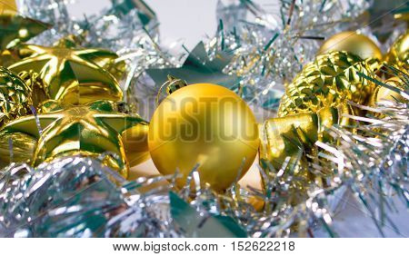 Christmas or New Year photo background with silver ribbon and gold fir tree toys. Festive winter holiday composition. Christmas greeting card. New Year banner template. Silver and gold decor picture