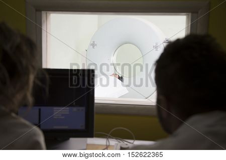 scientist Scanning the brains of patients with a Ct scan