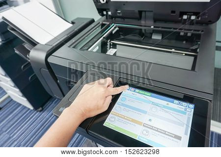 Businesswoman with printer touchscreen for scanning documents
