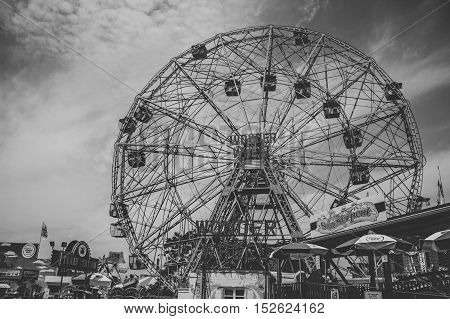 summer day in coney island amusement park with the wonder wheel