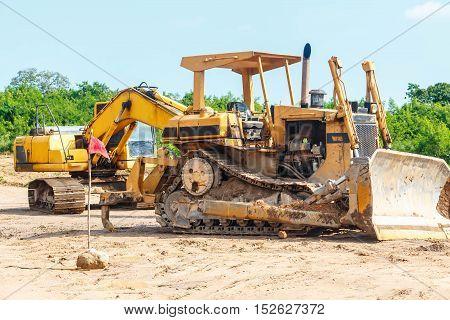 Closeup skid steer loader excavator at road construction work