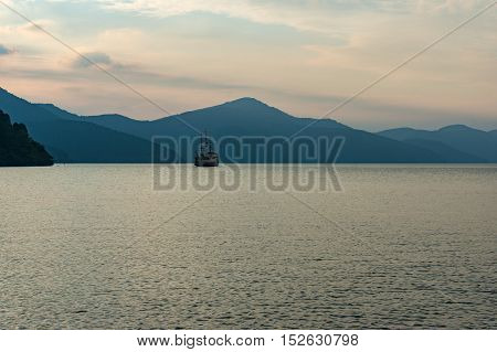 Mountain Lake In Dusk Mist With Old Fashioned Ship