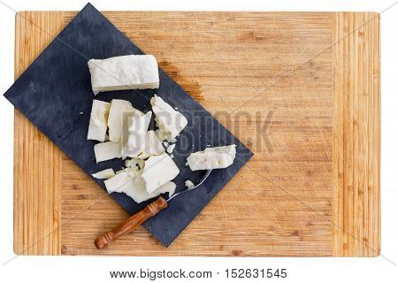 Cut Pieces Of Feta Cheese And Fork