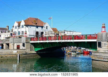 WEYMOUTH, UNITED KINGDOM - JULY 18, 2016 - View of the twin leaf bascule bridge in the harbour Weymouth Dorset England UK Western Europe, July 18, 2016.