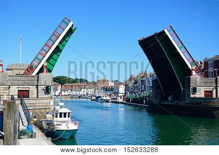 WEYMOUTH, UNITED KINGDOM - JULY 18, 2016 - View of the twin leaf bascule bridge and boats in the harbour Weymouth Dorset England UK Western Europe, July 18, 2016.